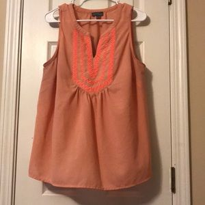 Peach and coral colored blouse